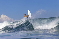 Indonesia, Bali, Surfer on wave - KNTF000317
