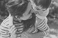 Playful mother and son outdoors - VABF000542