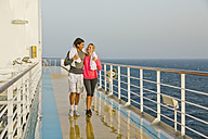 Couple walking in the morning light on a shipdeck, cruise ship, Mediterranean Sea - ONBF000057