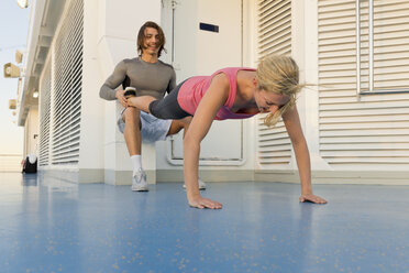 Young couple exercising in the morning on deck of a cruise ship - ONBF000060