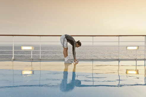 Young man doing exercises on a shipdeck, cruise ship, Mediteranean Sea - ONBF000062