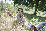 Relaxed young couple in field - ZEF008674