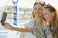 Two smiling women taking a selfie on a cruise ship - ONBF000066