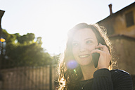 Portrait of smiling woman telephoning with smartphone - BOYF000403