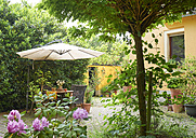 Cozy yard of an one-family house in summer - BSCF000531