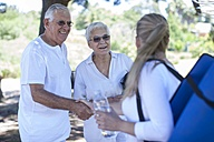 Elderly couple meeting with fitness instructor - ZEF008682
