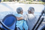 Elderly couple relaxing at waterside - ZEF008709