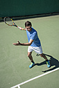 Tennis player prepared to hitting a ball with his racket during a tennis match - ABZF000651