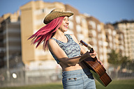 Young woman with hat playing guitar - JASF000819