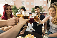 Friends in a bar toasting with beer glasses - JASF000849