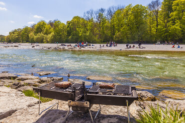 Germany, Munich, steaks on grill at riverside of Isar - WDF003635