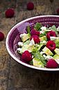 Bowl of avocado raspberry salad with feta, close-up - LVF004940