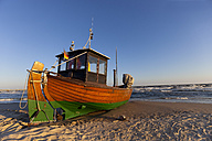Germany, Usedom Island, Ahlbeck, fishing boat on beach - KLRF000369