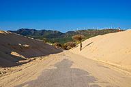 Spain, Andalusia, Tarifa, Road between dunes in Punta Paloma - KIJF000447