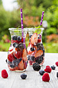 Two glass bottles of detox water infused with different berries - SARF002756