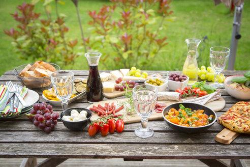 Variety of Mediterranean antipasti on garden table - SARF002762