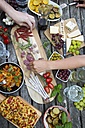 People enjoying variety of Mediterranean antipasti - SARF002765
