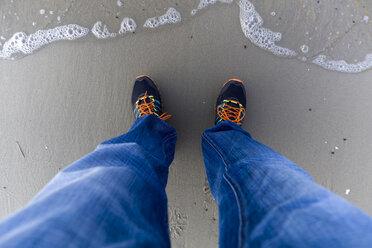Man's legs and feet at seashore - KLRF000379