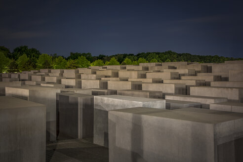 Germany, Berlin, Holocaust memorial at night - NK000466