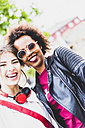 Portrait of two happy best friends taking selfie - UUF007655