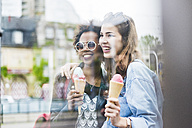 Two best friends with icecream cones - UUF007664