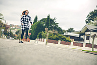 Young woman skateboarding on the street - DAPF000124