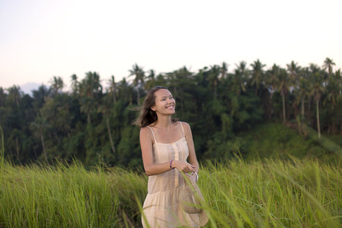 Indonesia, Bali, portrait of smiling woman in fields - KNTF000343