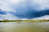Germany, North Rhine-Westphalia, Rhine riverbank and stormy atmosphere - SKAF000014