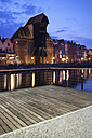 Poland, Gdansk, Motlawa bank with crane gate at dusk - ABOF000086