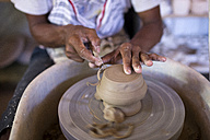 Man in workshop working on pottery - KNTF000362