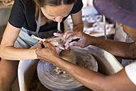Man and woman in workshop working on pottery - KNTF000374