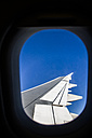 Airplane wing from a window of an airplane - ABZF000690