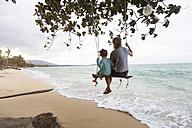 Thailand, family on beach, sitting on swing - SBOF000045