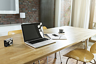 Dining room table with laptop and camera - SBOF000054