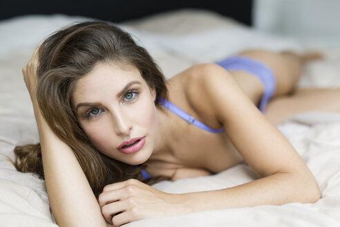 Woman in lingerie lying on bed - SHKF000610
