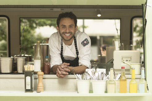 Portrait of smiling man in a food truck - SGF002062