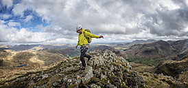 England, Cumbria, Lake District, Langdale, Harrison Stickle, climber - ALRF000547