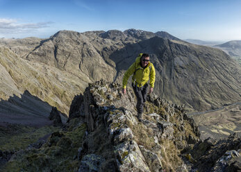 England, Cumbria, Lake District, Wasdale Valley, Great Gable, climber - ALRF000577