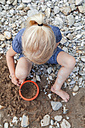 Blond little girl playing with sand in nature - TCF005001