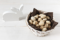 White wooden Easter bunny and basket of waffle eggs - EVGF002982