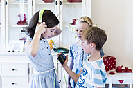 Children with cell phone and headphones - MJF001876