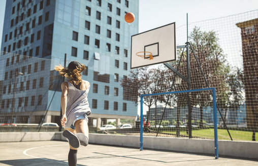 Young woman aiming at basketball hoop - DAPF000153