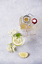 Glass of water flavoured with elderflower sirup and lemon - MYF001552