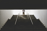 Young man walking downstairs - FMOF000012