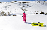Spain, Asturias, girl with sledge in the snow - MGOF001968