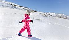 Little girl walking in snow - MGOF001980