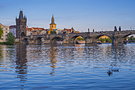 Czechia, Prague, Vltava river, Old town with Charles Bridge and bridge tower, water tower of old mill in the background - WGF000877