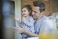 Father and little daughter clapping hands - ZEF008739