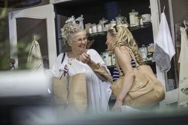 Two women shopping in vintage store - ZEF008775
