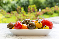 Plate of different tomatoes - SARF002779